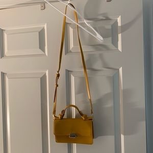 A new day yellow purse
